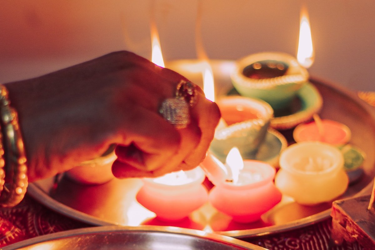 woman lighting candles as part of her spiritual practice