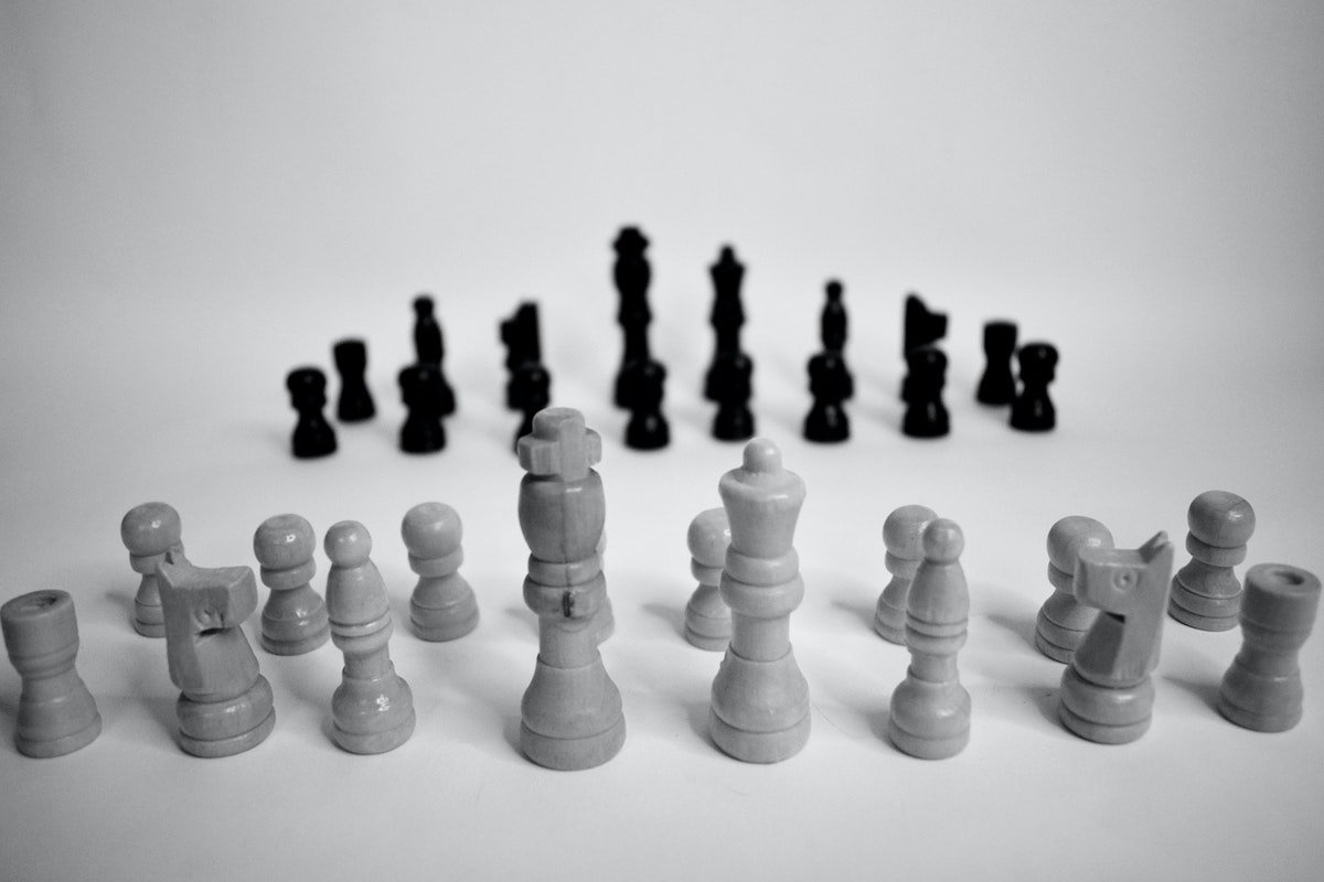 black and white picture of chess pieces illustrates us vs them mentality