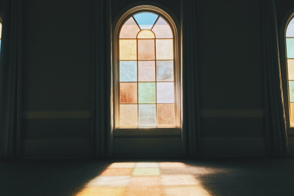 stained glass casts shadow on church floor
