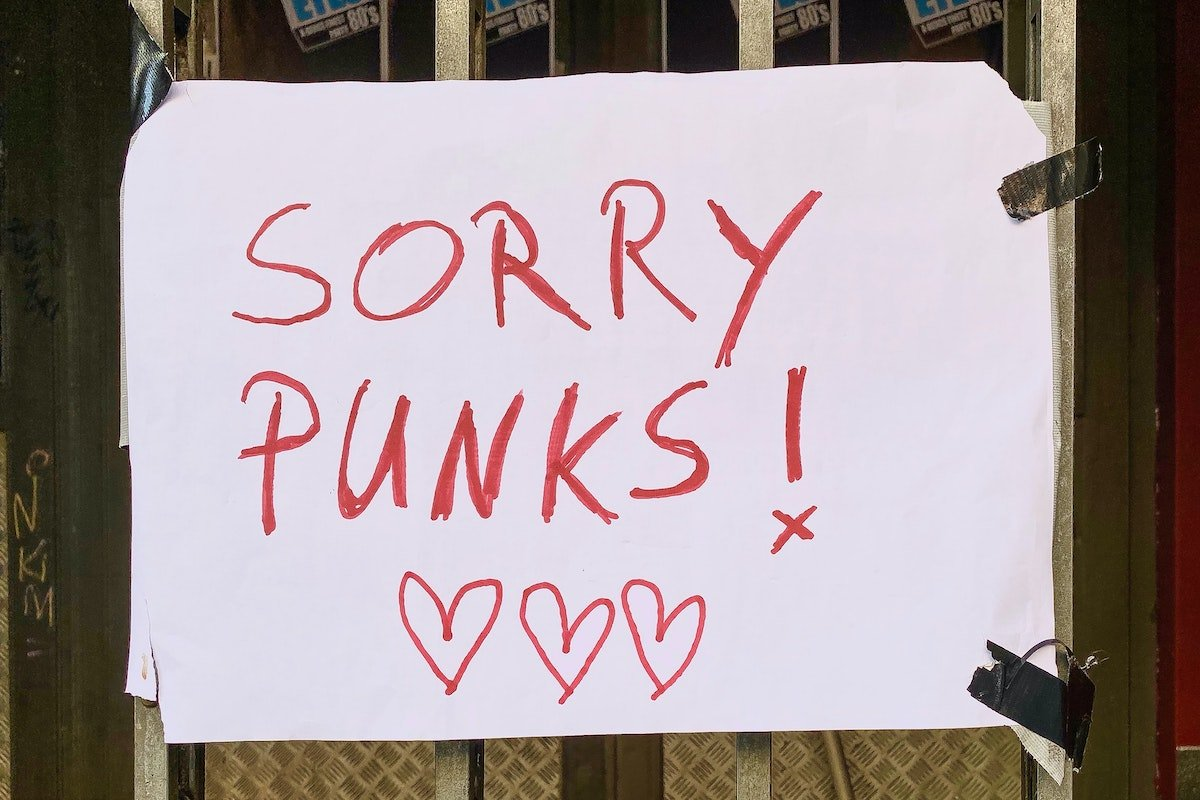 "paper sign that says ""sorry punks"""