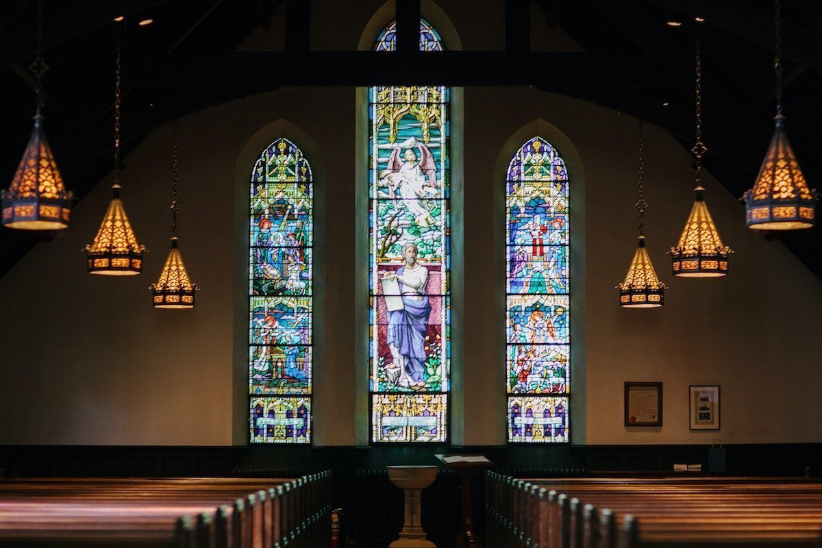 church interior with 3 stained glass windows