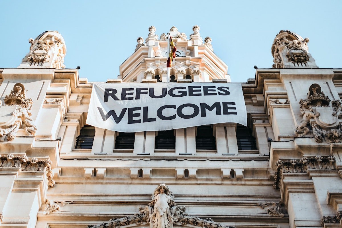Refugees Welcome banner on a public building