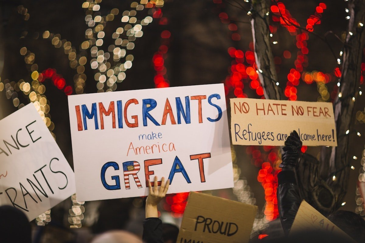 signs at a pro-immigration rally