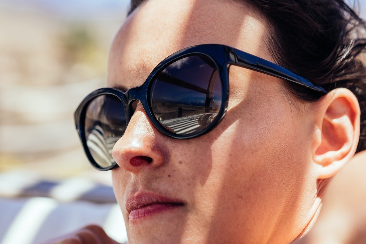 woman wearing dark sunglasses and being true to herself