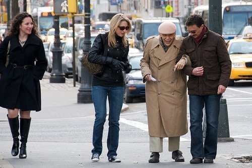 people helping old man on the street and overcoming evil with good