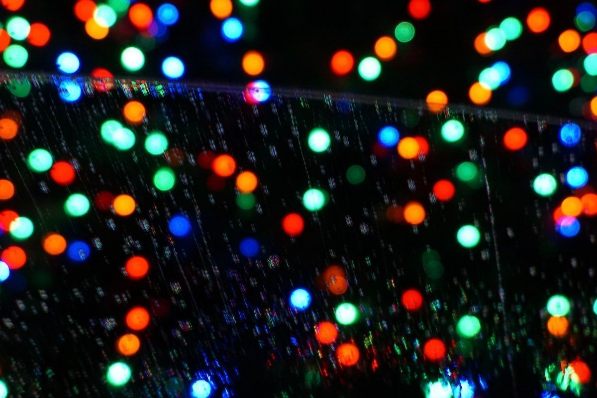 blurry Christmas lights against a black background