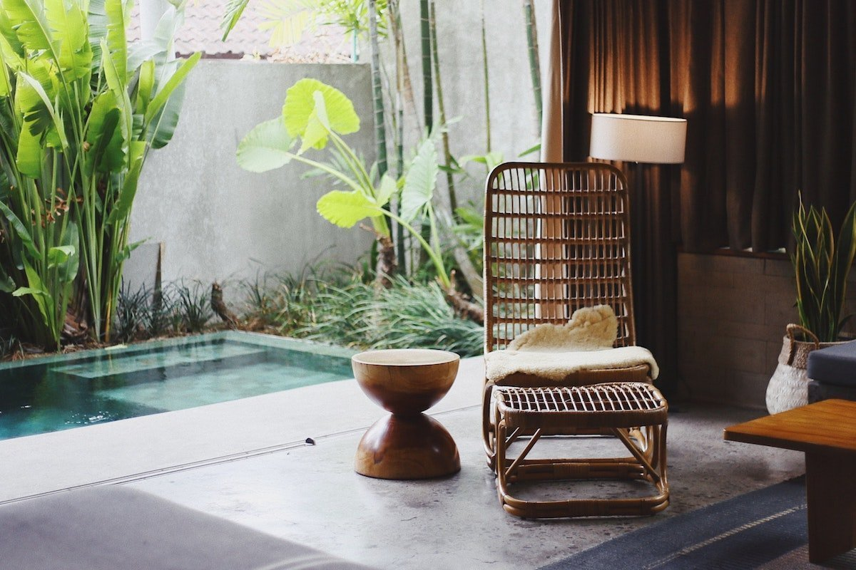 room with chair and water feature styled for simple living