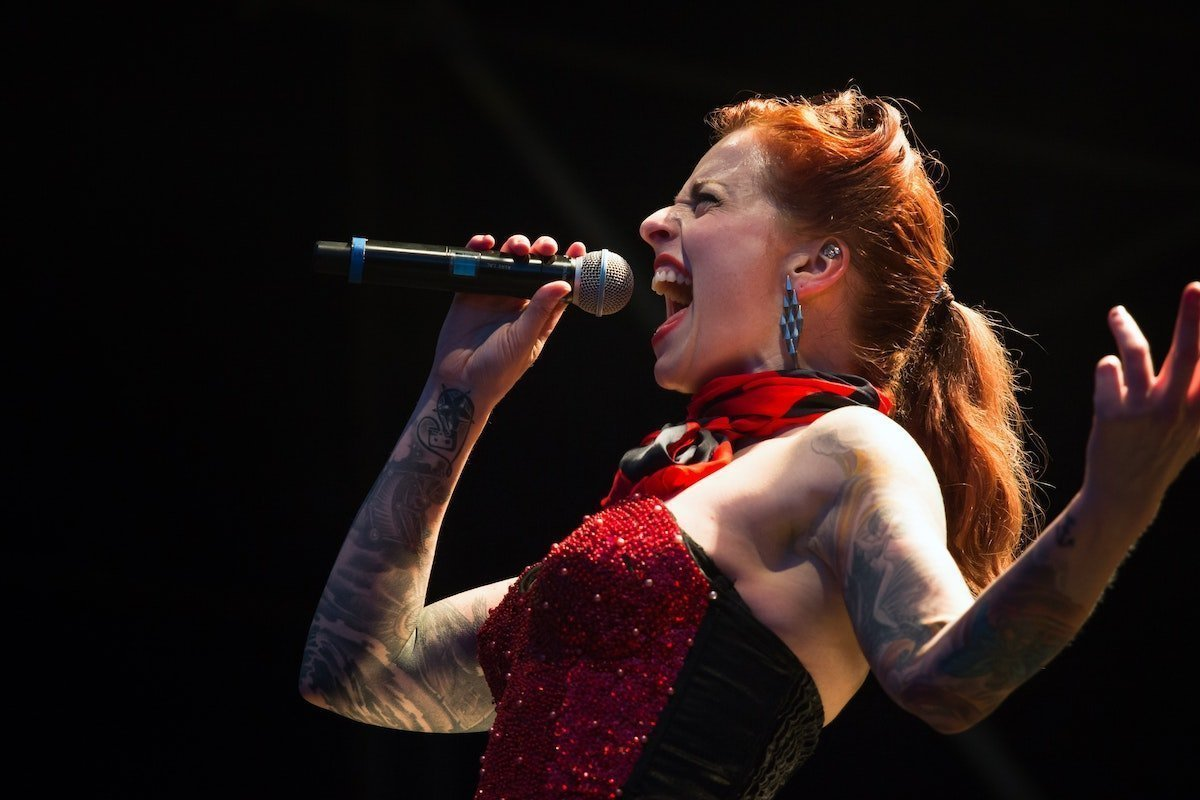 redhead woman singing her heart out